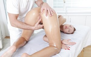 Masseur turns on visitor with red hair touching pussy and moreover she lets drill it