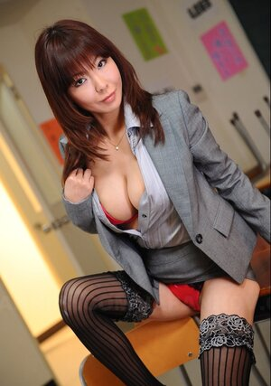 Oriental businesswoman wears too hot stockings and besides red lingerie under office outfit