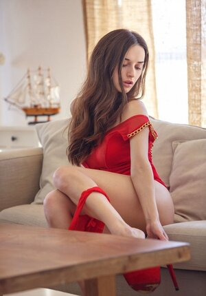 Chick looks sexy in red dress and additionally even sexier when she throws it away