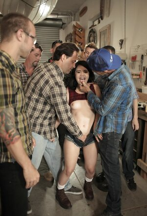 There are seven excited men but cheerful brunette bitch will give head all cocks