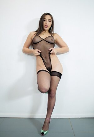 Woman talked admirers to take some pics of her wearing black bodystocking