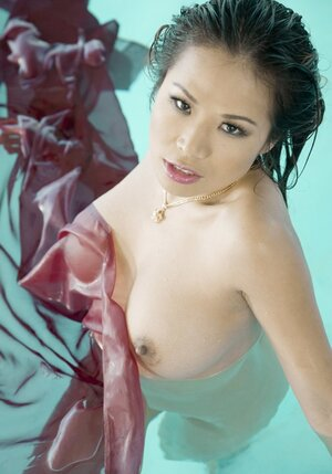 Exotic dame from Asia not shy to swim wholly naked in private pool