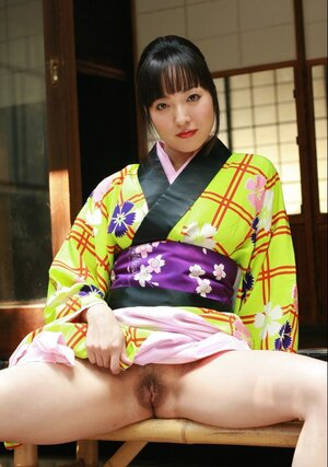 Swanky Japanese lady wears colorful kimono and also has no panties under it