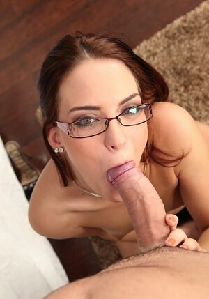 Redhead doesn't takes off glasses while gagging on partner's fuckstick