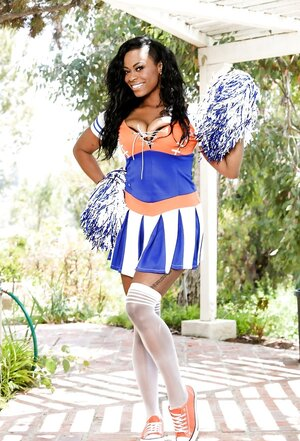 Ebony cheerleader Tori Taylor shakes her large appetizing ass in sexy uniform