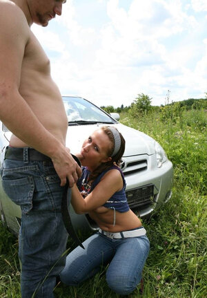Youthful virgin chick in striped headband fucked by long-haired boyfriend's car